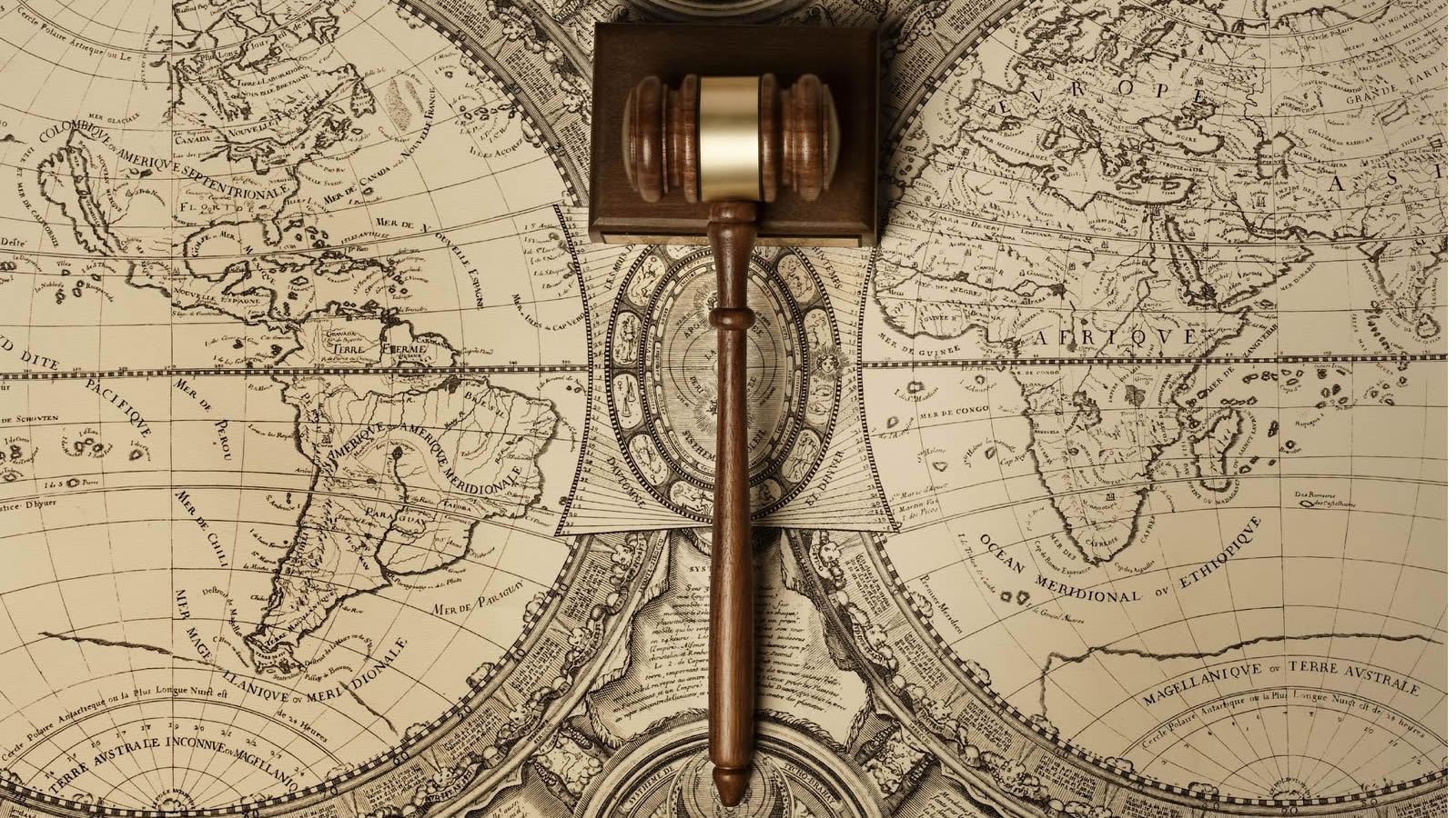Wooden Gavel on Antique Map