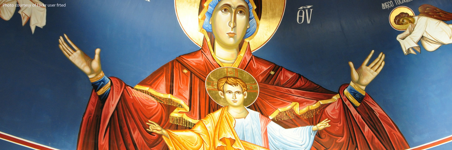 Church mural featuring Mary Theotokos and Baby Jesus raising hands to offer a blessing