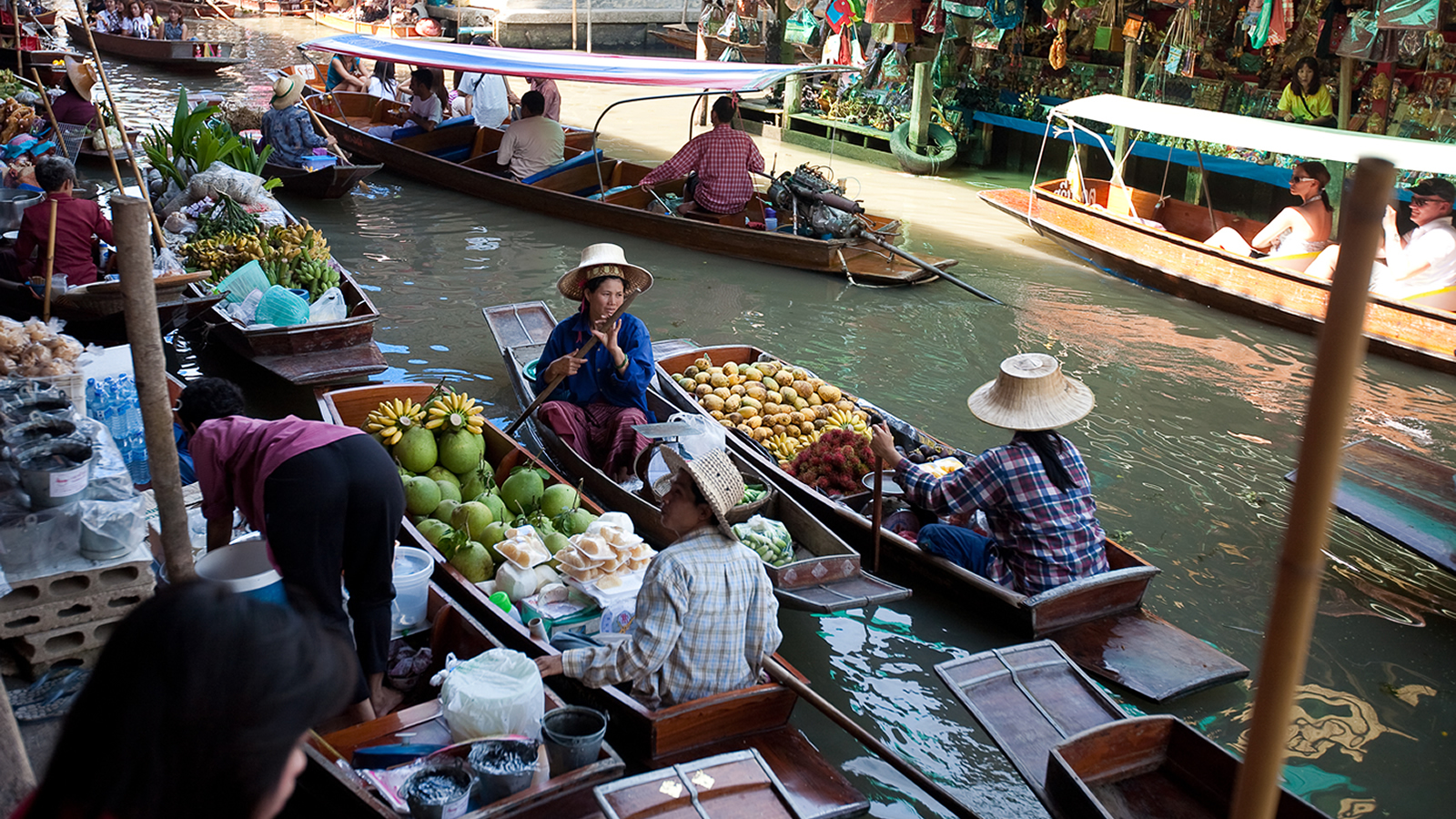Market Vendors Selling Fruit from Boats