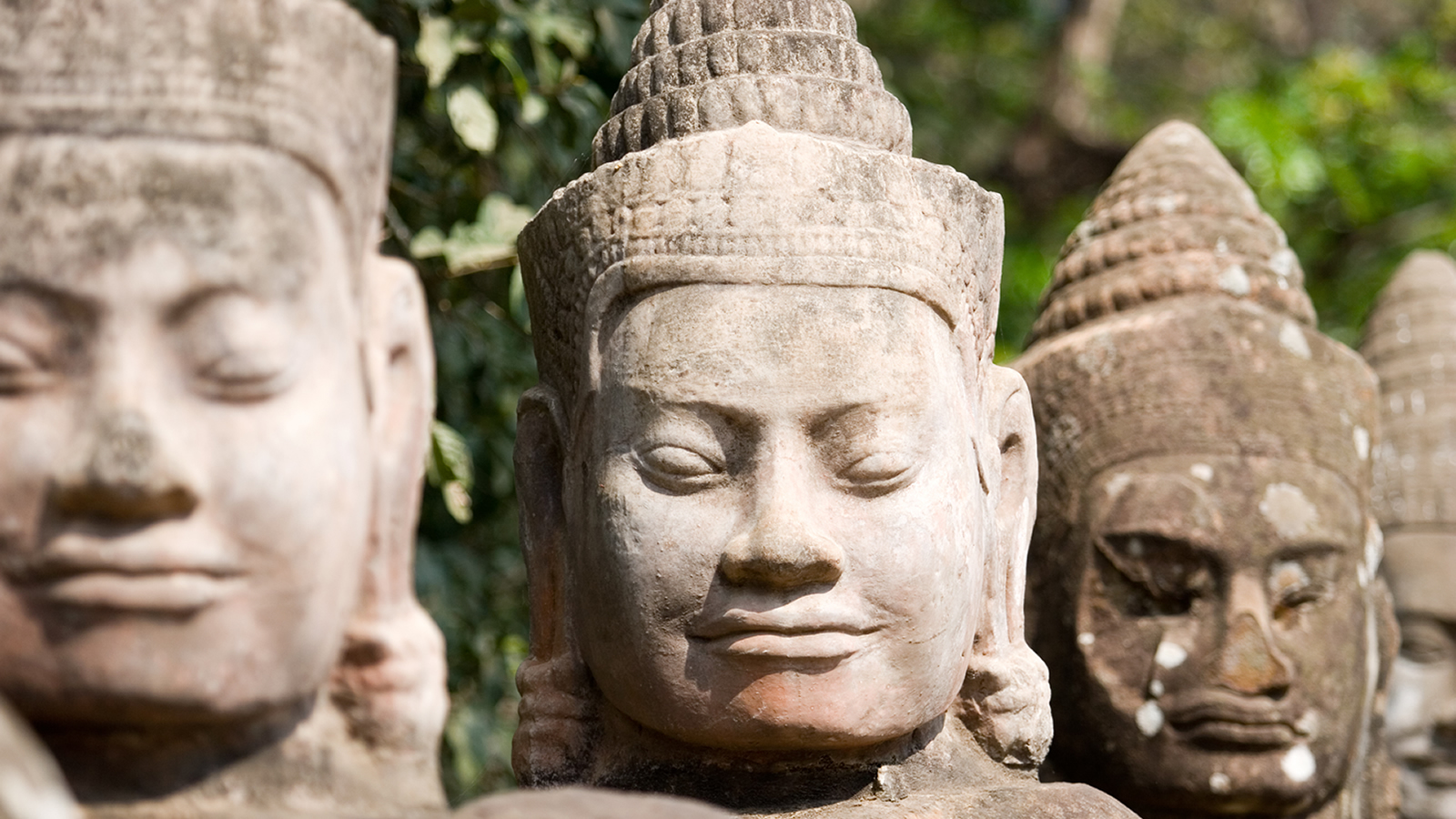 Row of Asian Stone Statue Heads