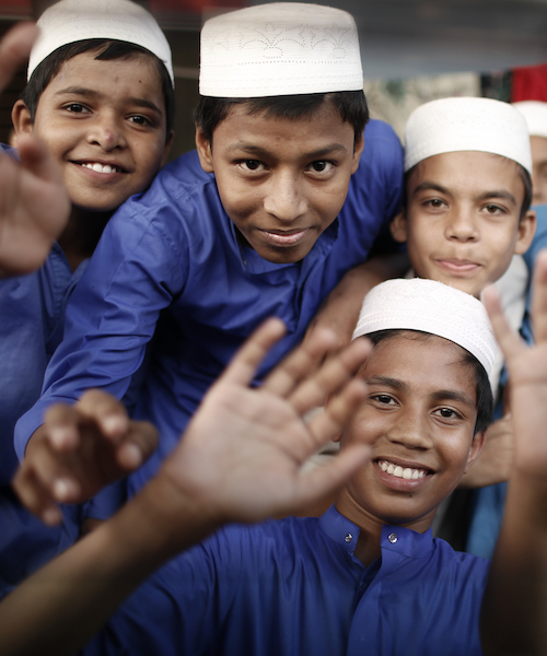 Male madrasa students standing together in Bangladesh