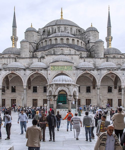 People standing outside the Blue Mosque in Istanbul