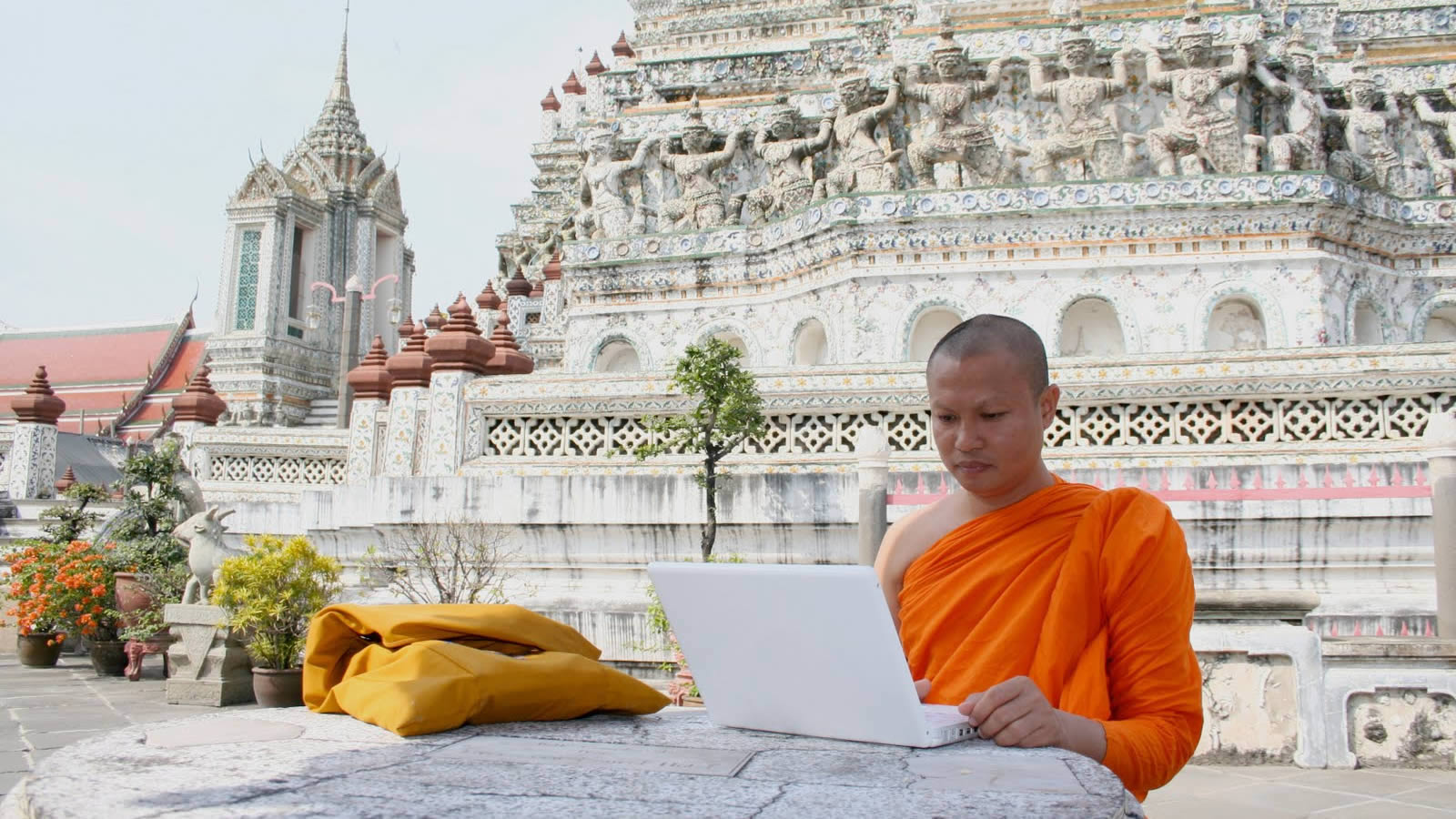 Buddhist Monk Using Computer