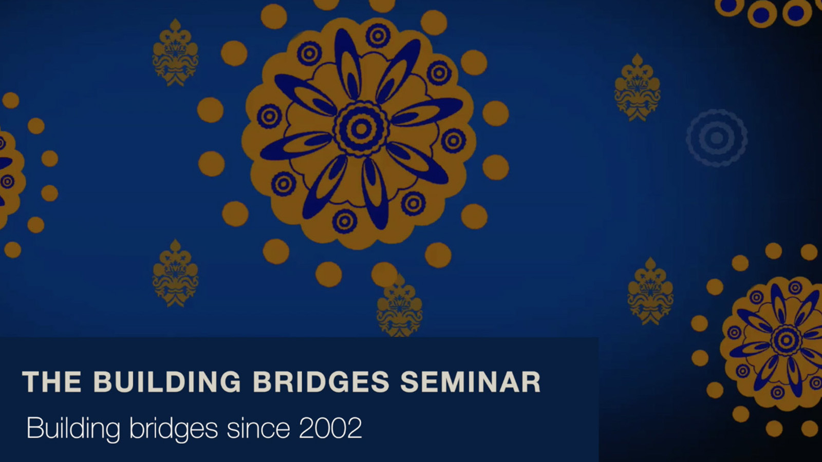 """The Building Bridges Seminar: Building bridges since 2002"" on blue and yellow patterned background"