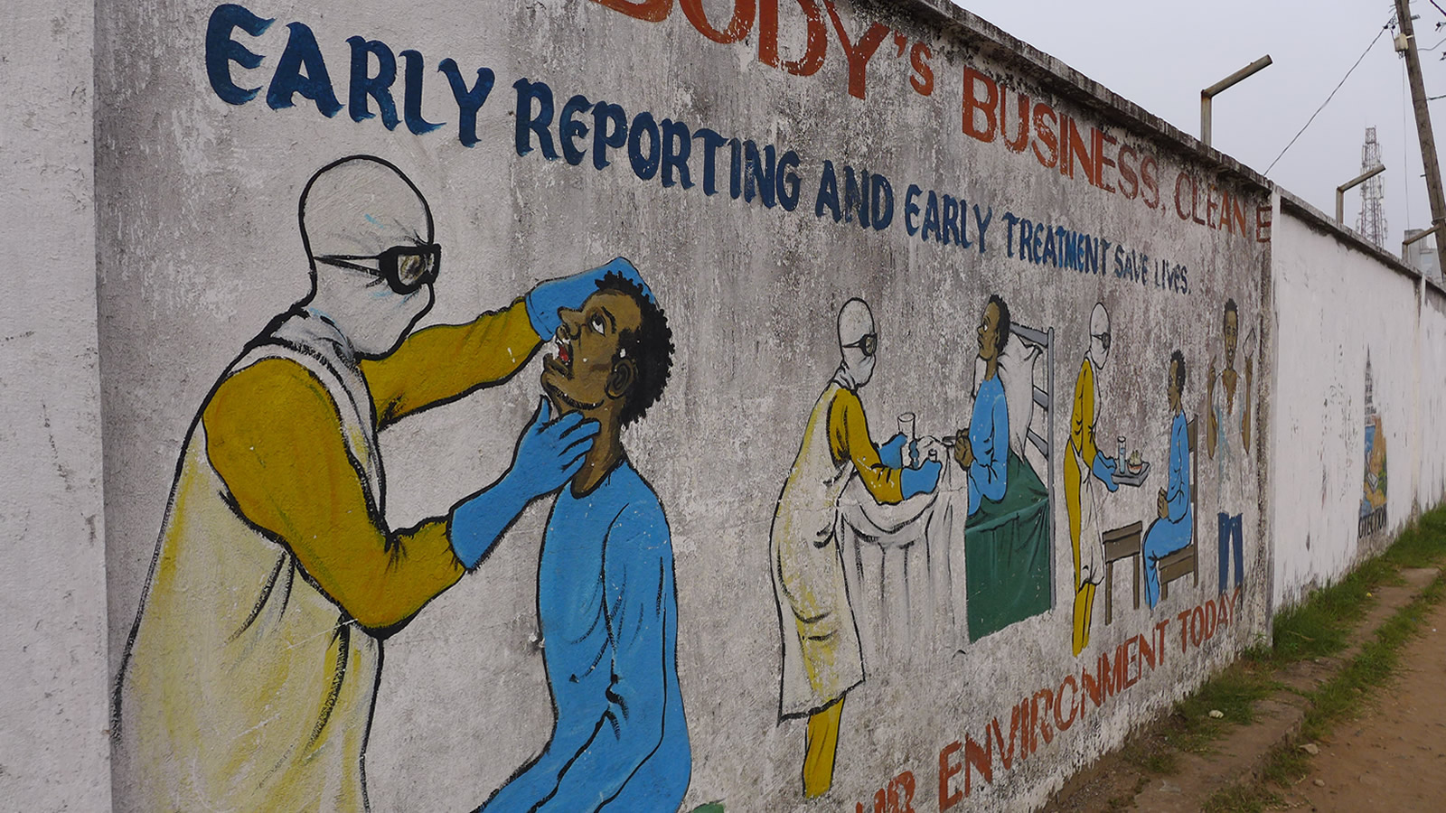 Mural of doctor and patient being treated for Ebola