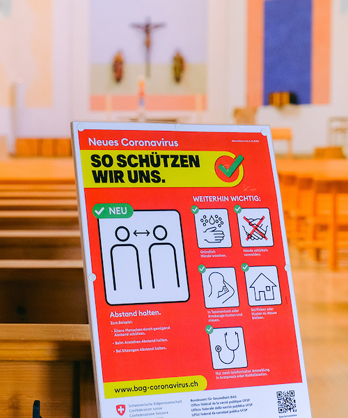 A sign warning of COVID-19 in a German church