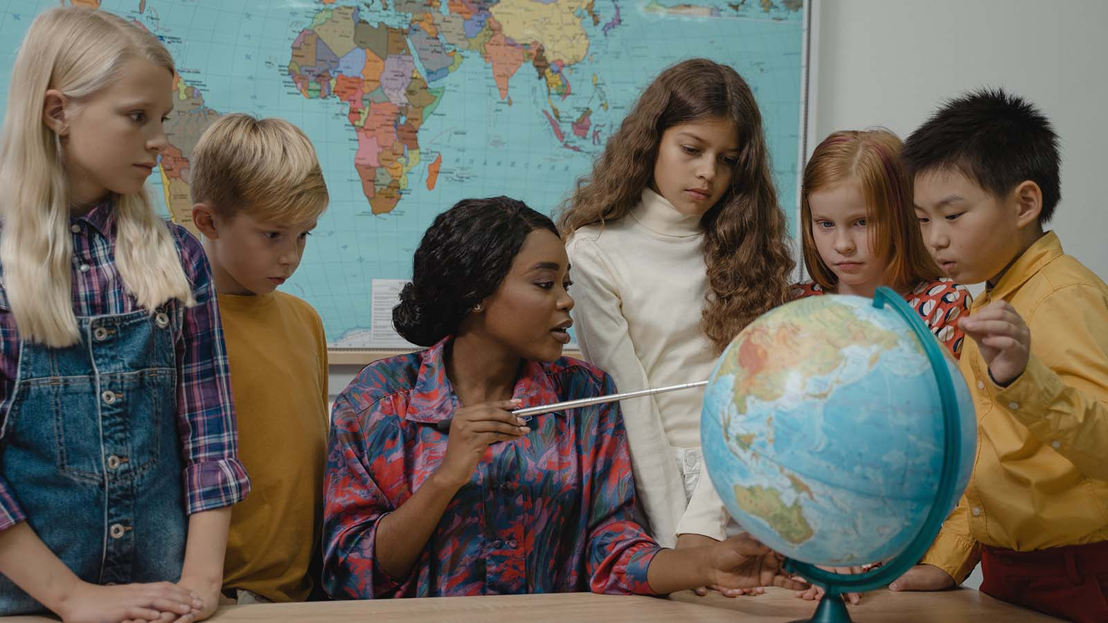 Children learning in a classroom about global affairs.