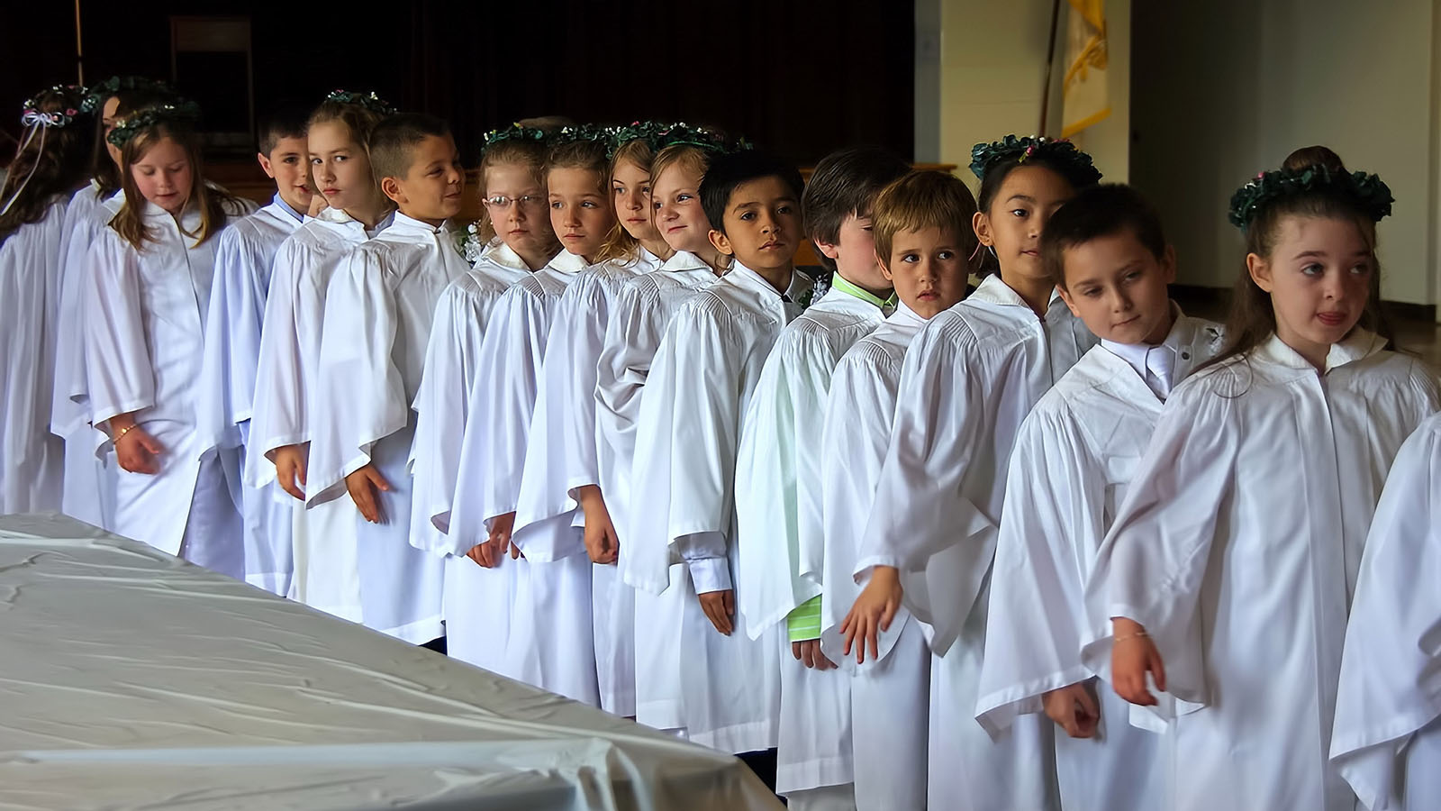 Children serving during mass line up in Middletown, CT