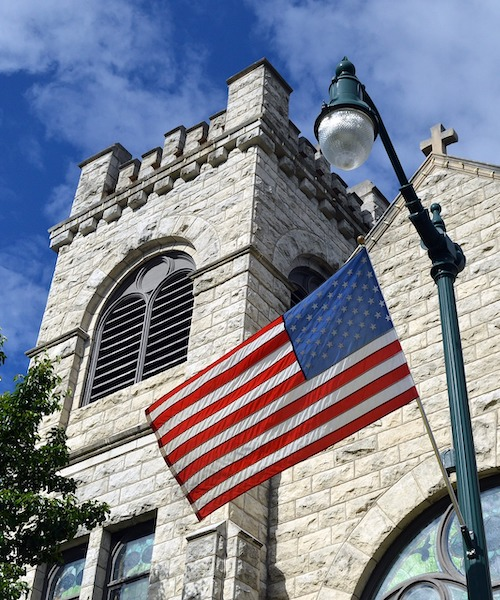 U.S. flag flies in front of a church