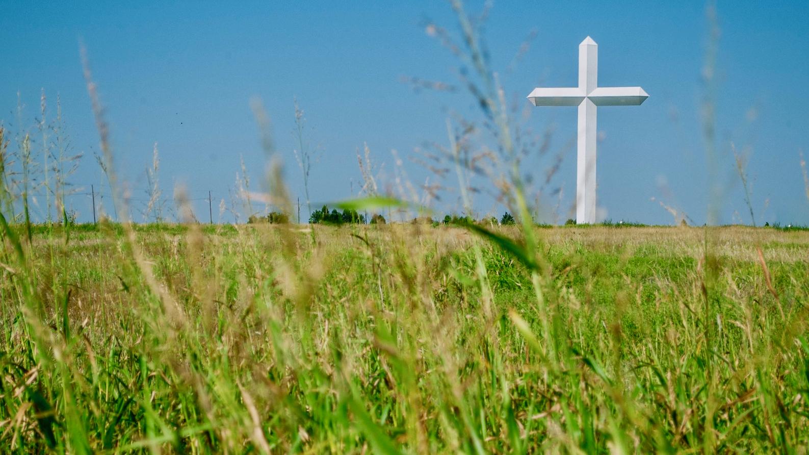Cross in a field.