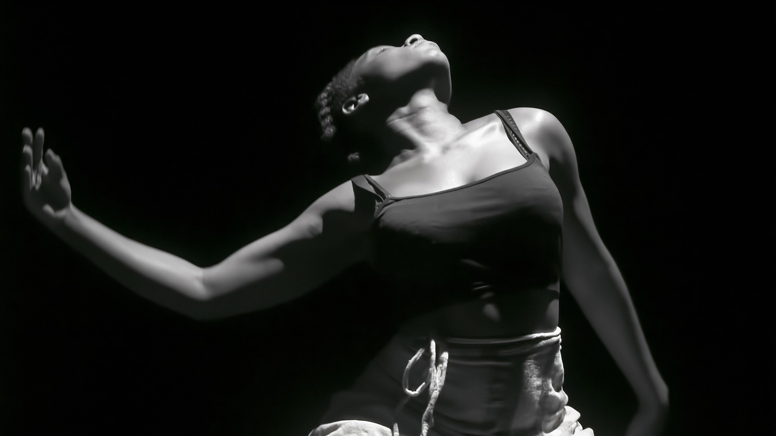 Black and white photo of a woman dancing.