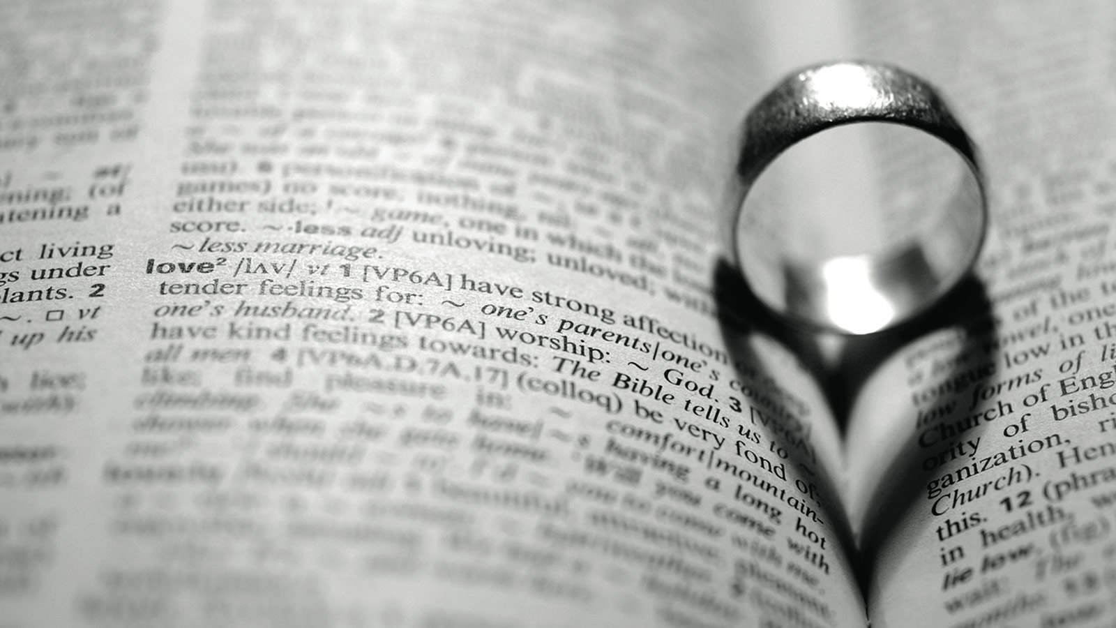 Wedding Ring on Dictionary with Definition of Love