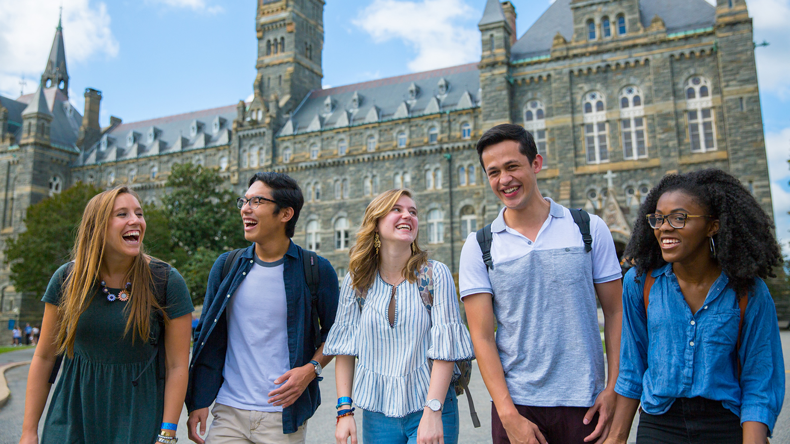 Diverse Georgetown Students Laughing in front of Healy Hall