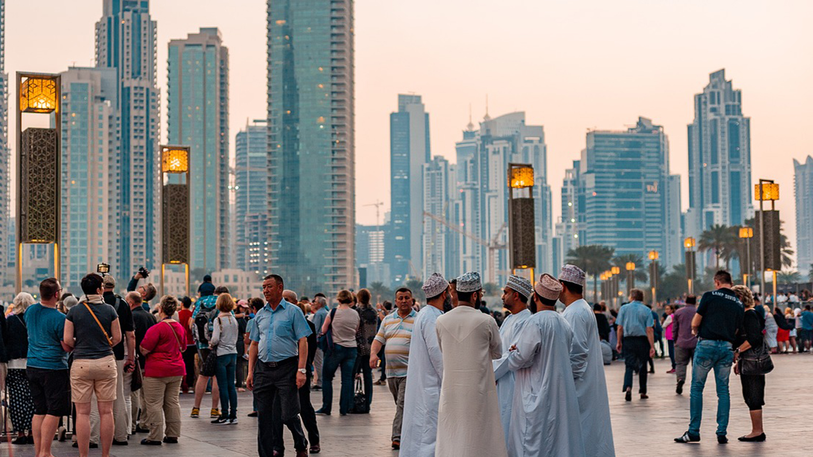 Religious and Secular crowd mingles in downtown Dubai, UAE.