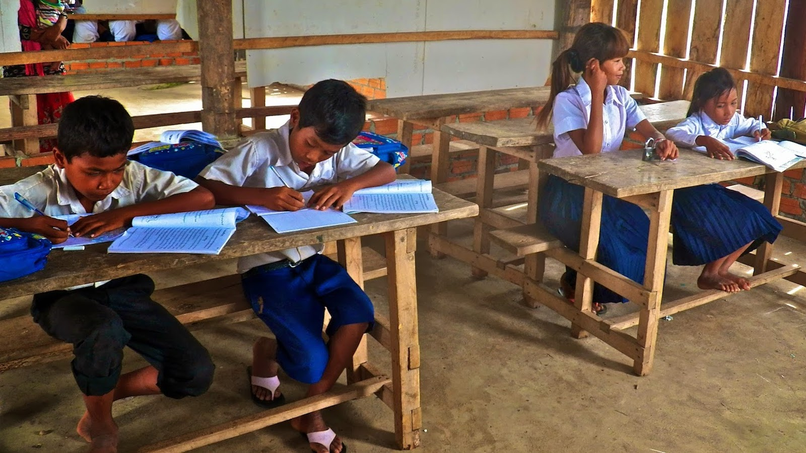 Students working at desks in Cambodia