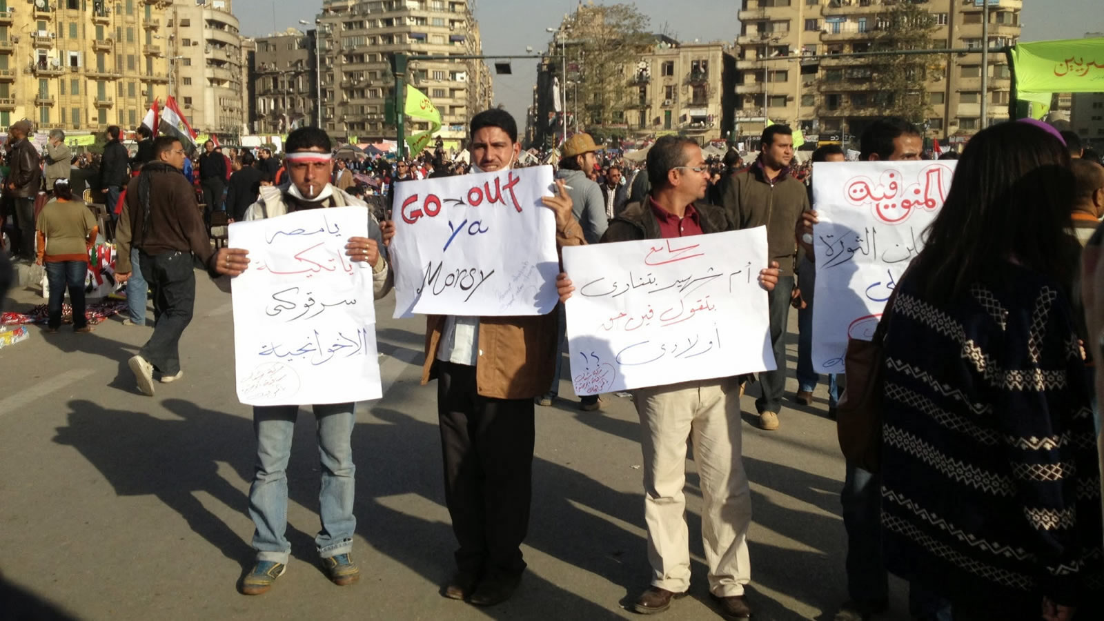 Protestors in Egypt with Signs in Arabic