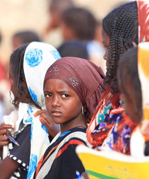 Schoolgirls and boys queue up in the schoolyard in Berahile, Ethiopia