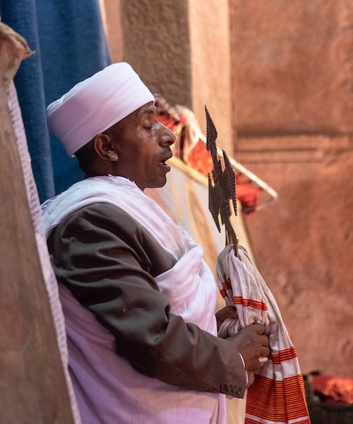 Man holding an Orthodox cross in Aksum, Ethiopia