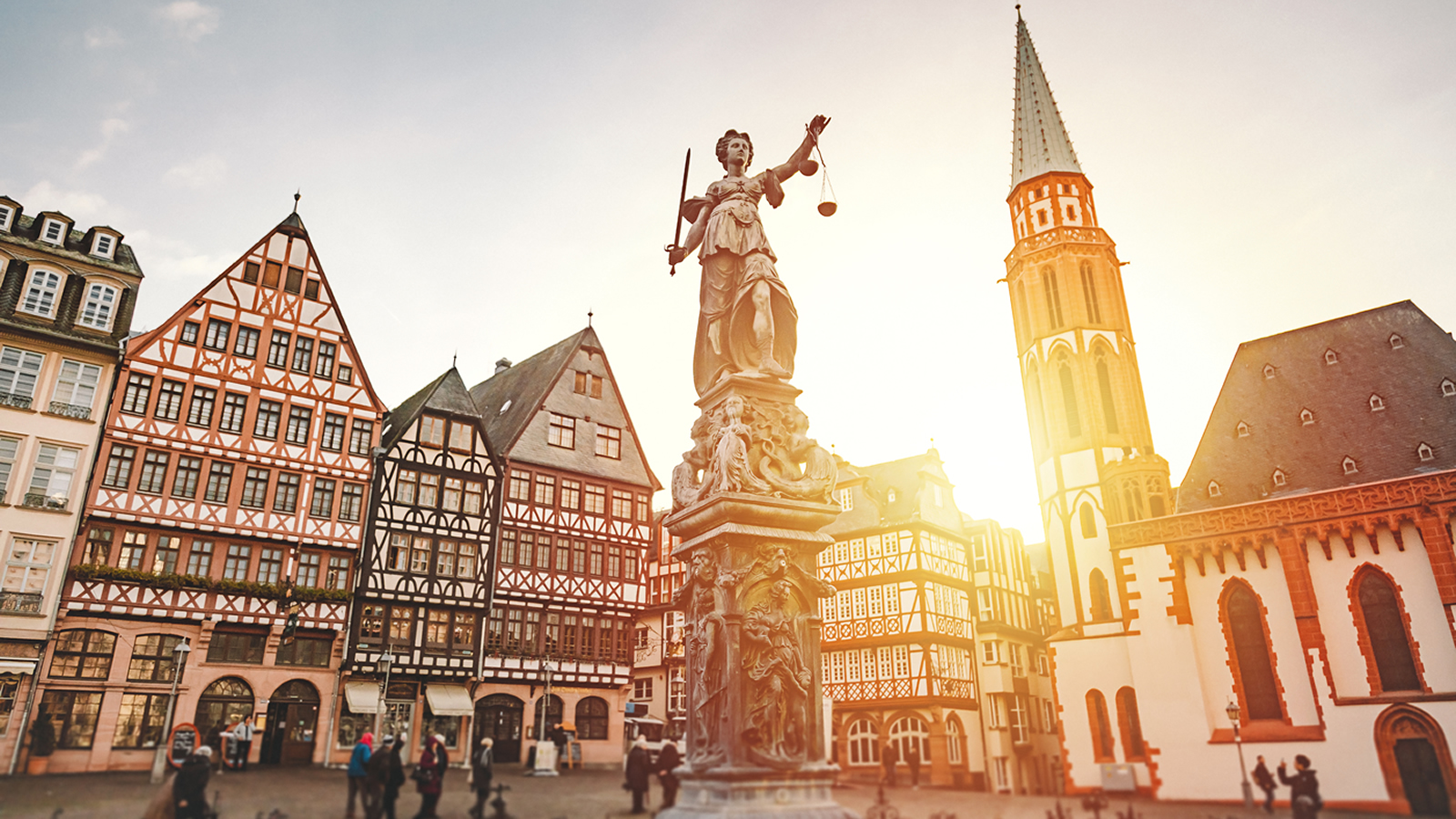 Town Square with Church and Lady Justice Statue in Frankfurt, Germany