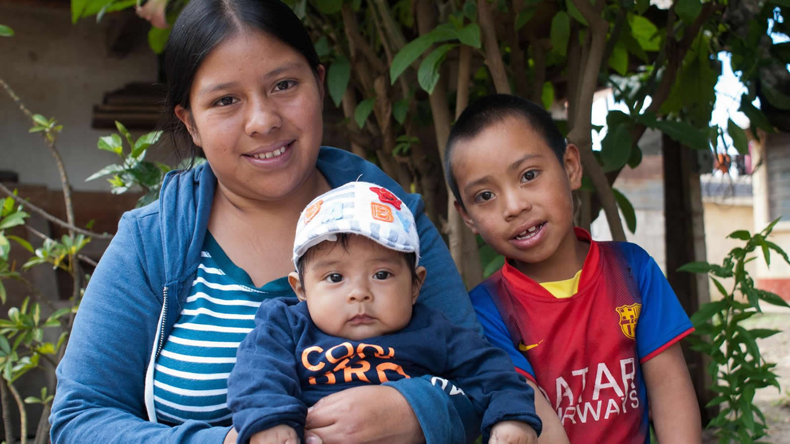 Woman with Two Children in Guatemala