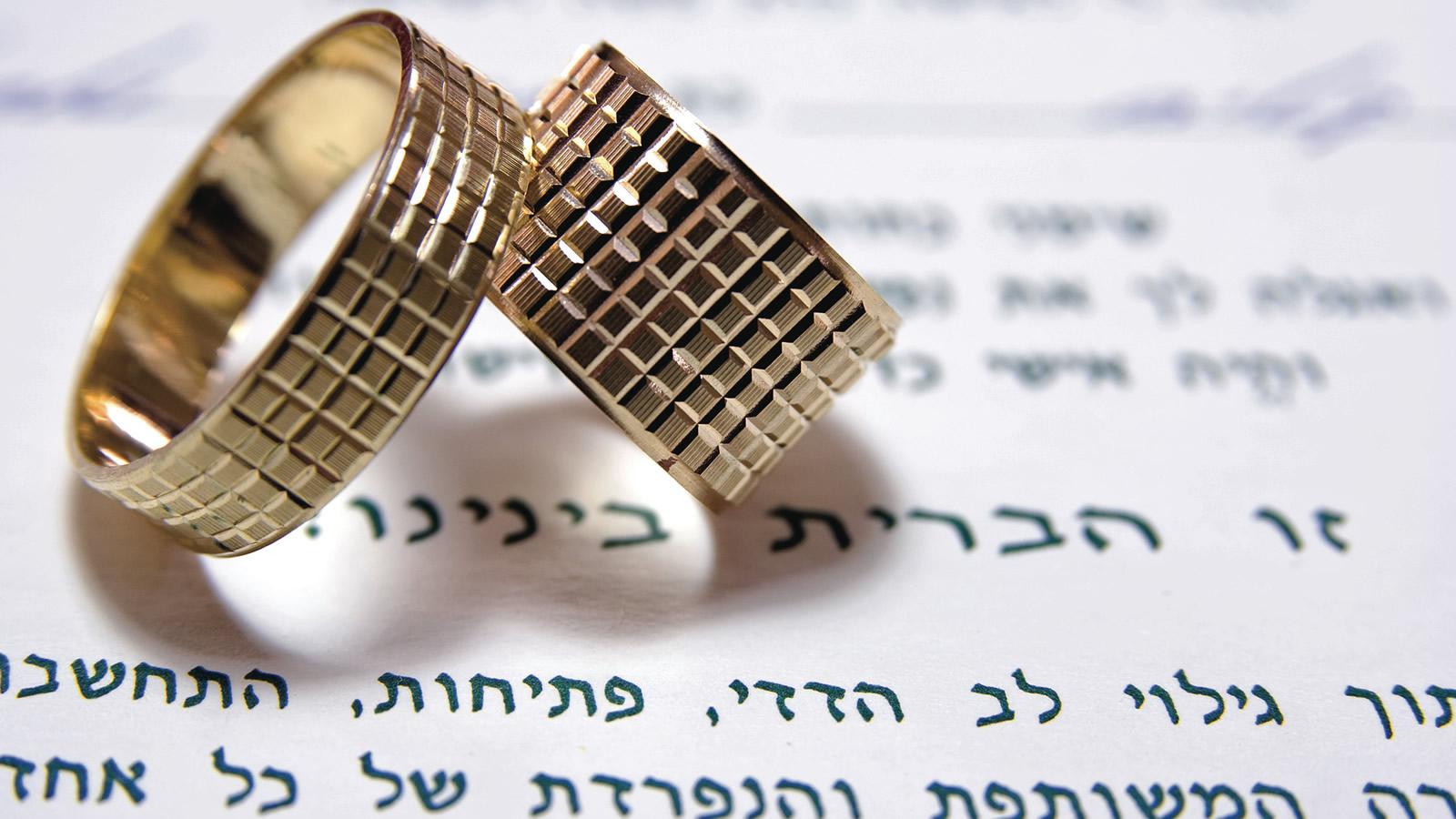 Wedding Rings on top of Hebrew Writing