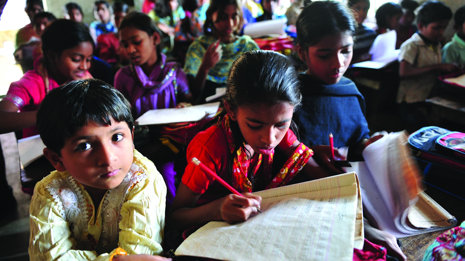 Indian Children at School with Girl Writing