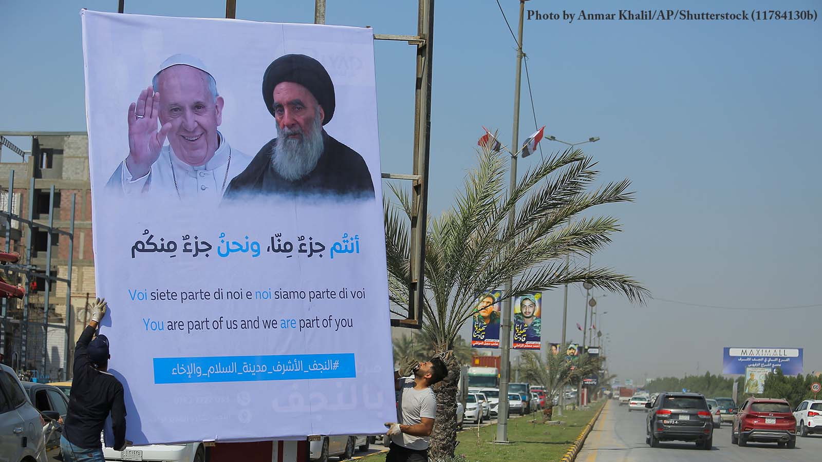 Poster of Pope Francis and Ayatollah Al-Sistani on an Iraqi street. Photo by Anmar Khalil/AP/Shutterstock