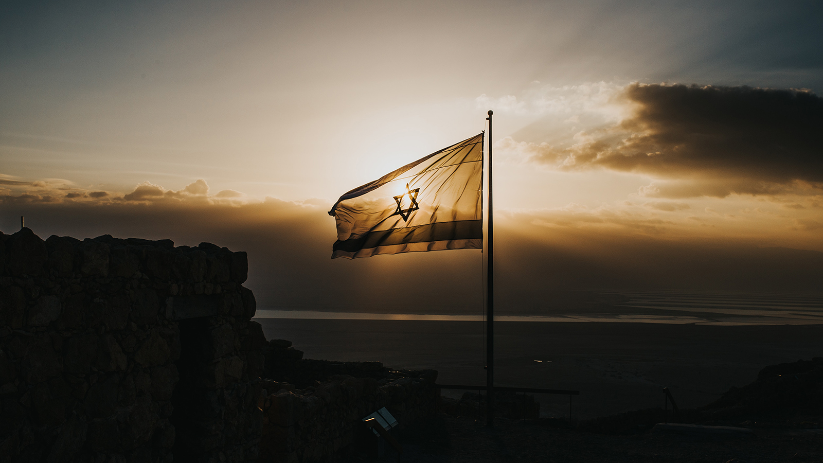 Israeli flag in front of the sun.
