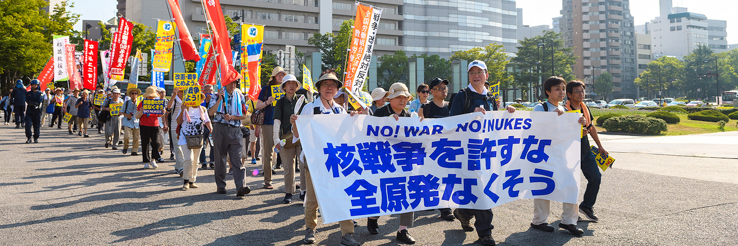 A crowd of people protest against nuclear weapons in Japan