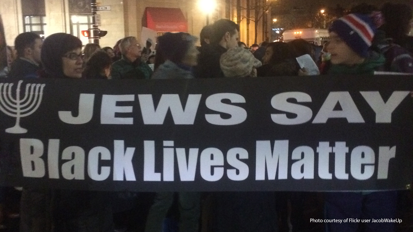 "Protesters holding a sign that says ""Jews Say Black Lives Matter."""