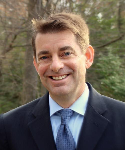 John K. Roman headshot