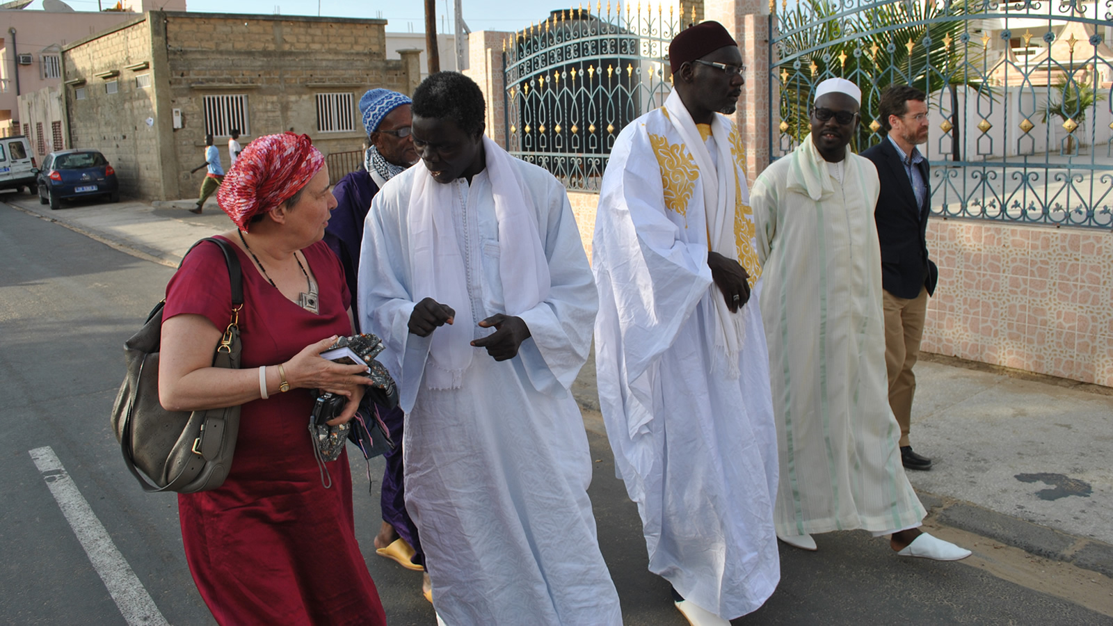 Katherine Marshall Talking to Senegalese Muslim Leaders in the Street
