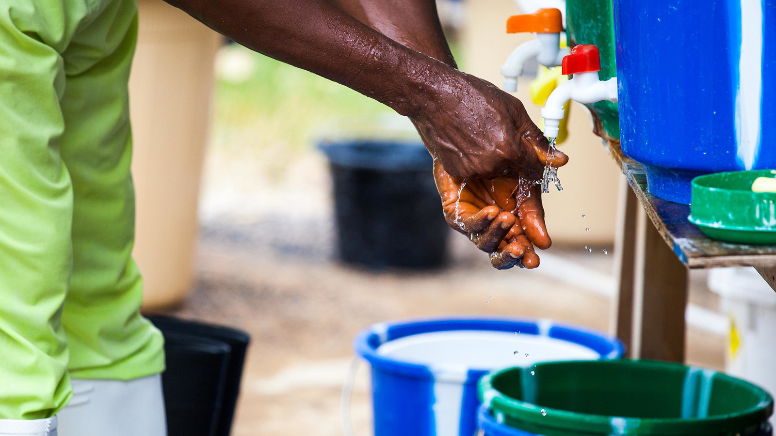 A Liberian nurse washing his hands after treating a patient.