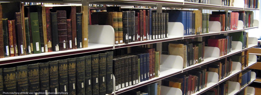 Library shelves with old books