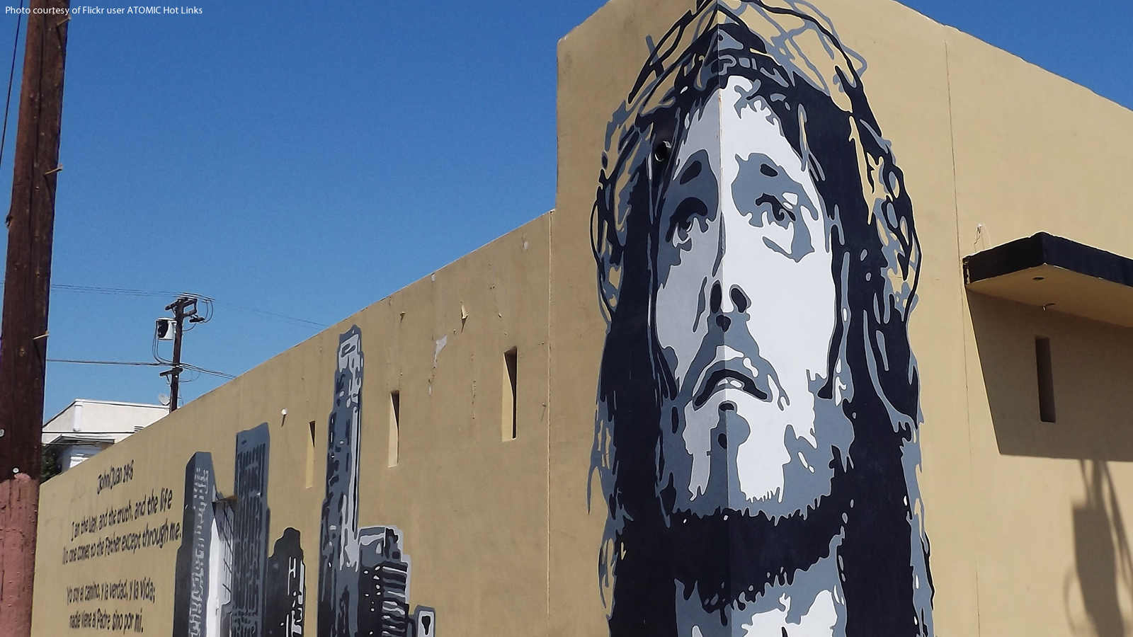 Building Mural featuring Jesus with a Crown of Thorns and a City Skyline