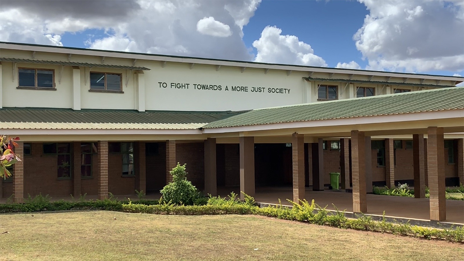 """Mural with """"To Fight Towards a More Just Society"""" at Loyola Jesuit Secondary School in Malawi"""