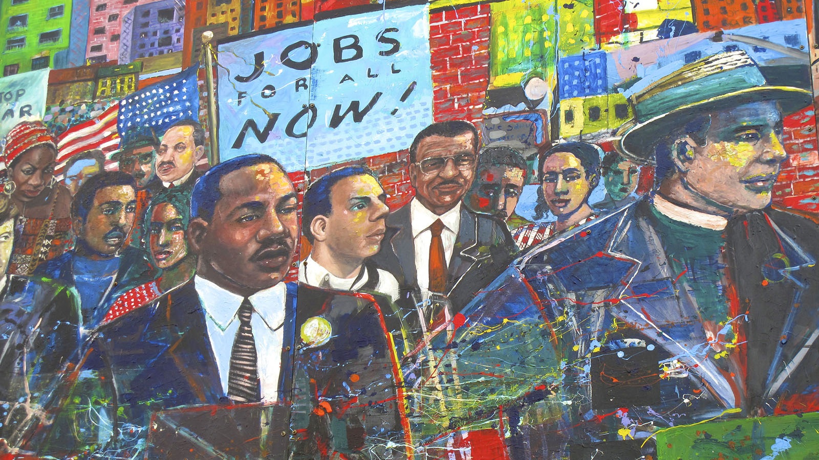 A mural shows Martin Luther King Jr. along with several prominent African Americans holding the sign - Jobs for All Now!