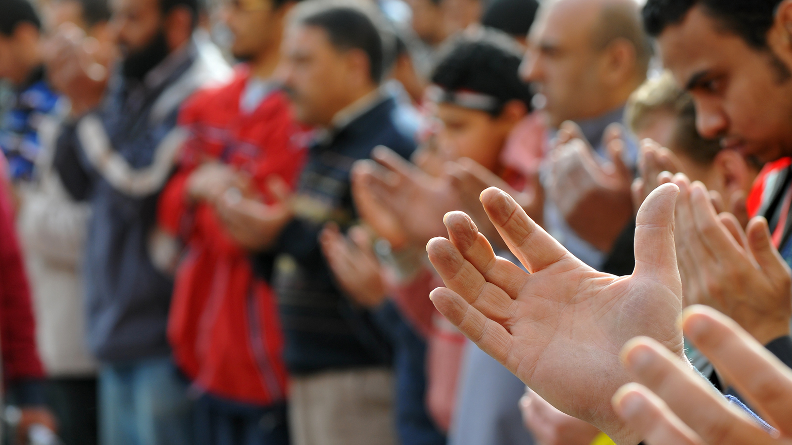 Men Praying with Hands Up
