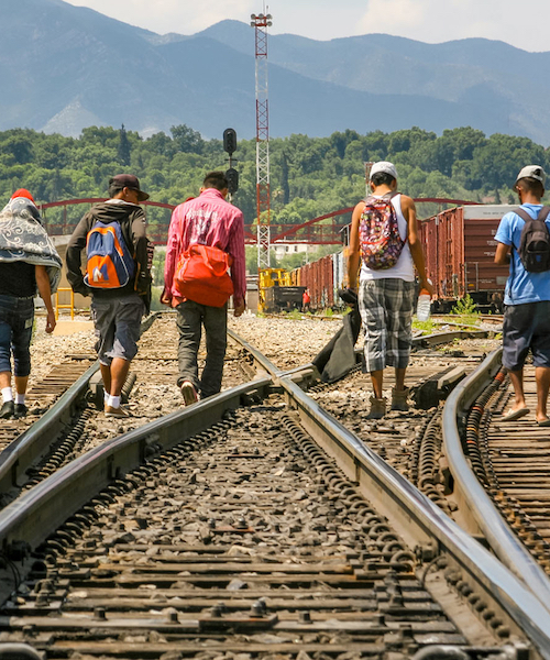Migrants on train tracks