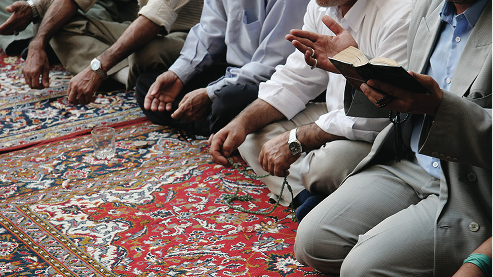 Muslim men in suits praying.