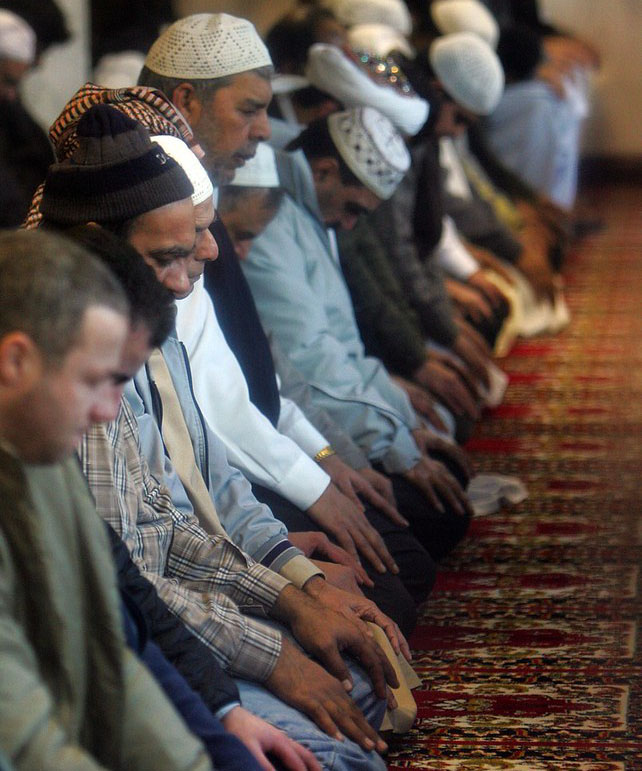 Muslim men praying in a mosque