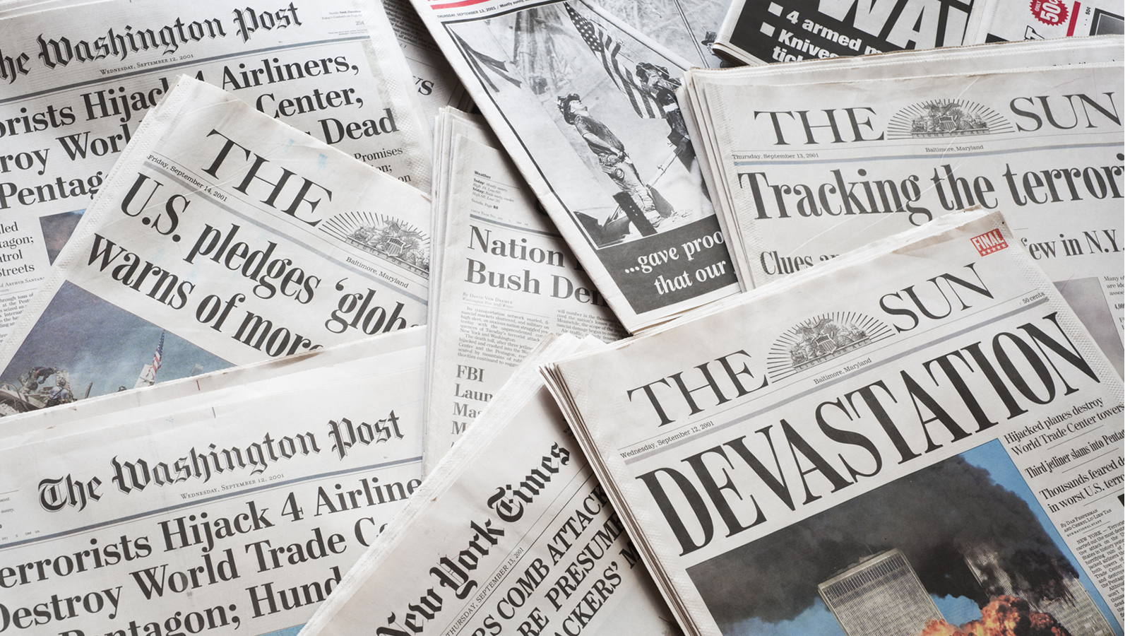 Newspapers with Headlines about the September 11, 2001 Terrorist Attacks