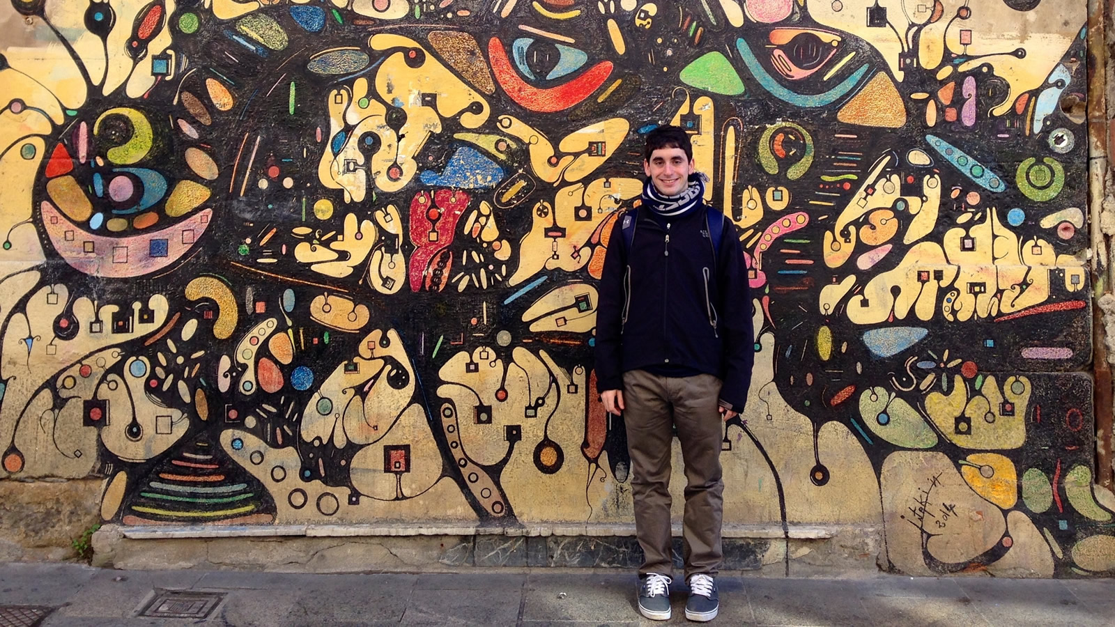 Nick Cortina in Front of Mural in Salamanca, Spain