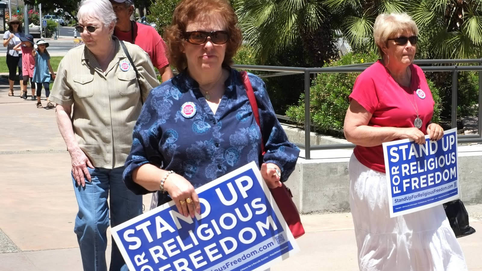 Older Women Protesters Holding Stand Up Religious Freedom Signs