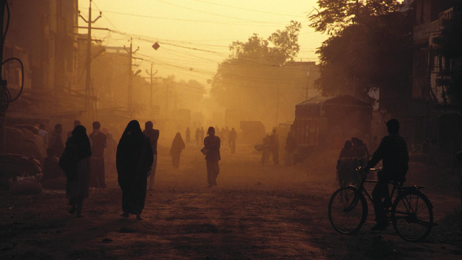 People Walking on Dusty Street