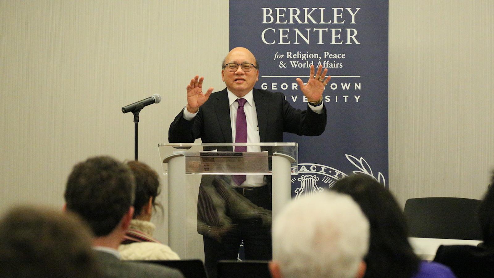 Peter Phan speaks at podium