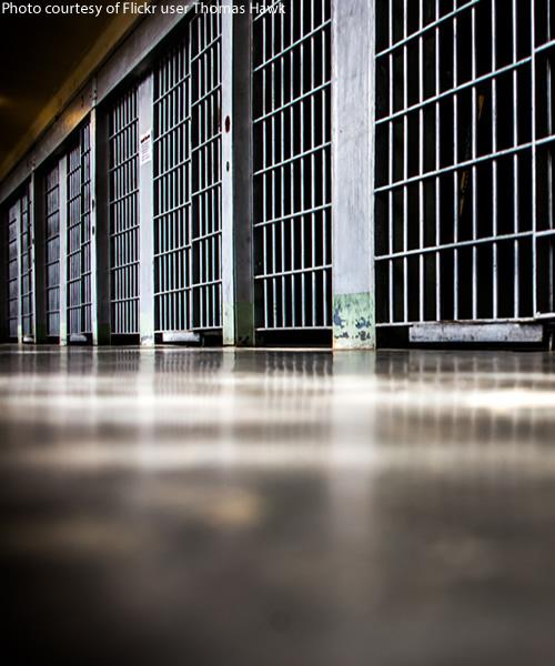 Prison Cells Line a Hallway