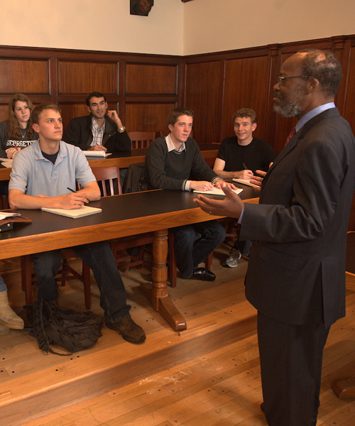 Professor and Students in a Wood-Paneled Classroom