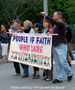 Religious leaders carrying banner in gay pride parage