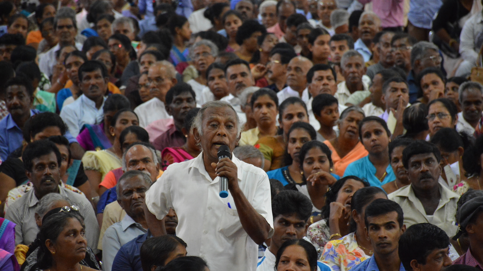 Man speaking in crowd at a Sarvodaya Shramadana Movement